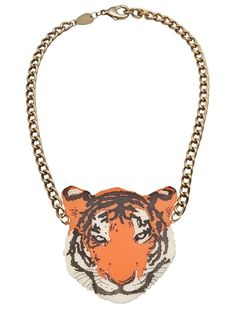 Tiger necklace in orange from Tatty Devine featuring a chain necklace with hook closure and tiger pendant.