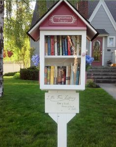 Corner of H and Kiernan in Northwest Spokane.  This little free library was the very first library we built and was a Christmas gift for Tom's sister, who teaches English at Mead High School and is an avid reader. We wanted it to have a Victorian look, painted it to match her front door, and put sconces on both sides so she can change out her flowers/decorations to match the season or holidays!  Built by Little Library Builder of Spokane!! littlelibrarybuilder@gmail.com