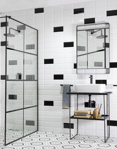 Create a fabulously trendy monochromatic bathroom with black and white metro tiles, trend-forward hexagonal mosaics and the latest in black bathroomware. Add pops of colour with the towels and accessories, to really make it yours. #trendingdesign #home #homedecor #monochromatic #bathroom #blackandwhite