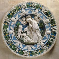 Andrea Della Robbia ( 2 nov. 1435 - 14 août 1525). La Vierge adorant l'Enfant-Jésus en présence de saint Jean Baptiste et de deux chérubins. ca. 1500, Louvre