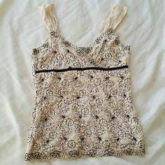 "Ann Taylor beaded cream tank. Ann Taylor. Beaded tank. It was a gift. I cut tags thinking I'll wear it one day but never. So the other tag ""remove before wearing or washing"" is still on. See third picture. Very cute top for business attire. This is a size Petite xxsp. So it will fit size 0 or 2. At the time I was 105/110 lbs.  Now... I wish I was that weight again. Open to offers. Ann Taylor Tops Tank Tops"