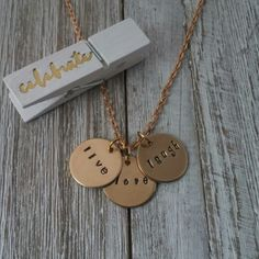 "It's not only in the words of live,love, laugh but it's also in the necklace that holds those words! •This hand stamped, inspirational necklace has the decadent look of luxury with the warm glow of the gold filled discs. •Each 1/2"" disc is stamped with attention to detail and then put on a elegant gold plated chain. The length of the chain is chosen by you. Your choices are 18"", 20"", 22"" or 24"". Just make your selection at the checkout. •Why not spoil yourself or a loved one with this…"