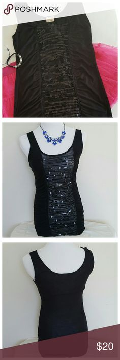 "Daytrip Black Sequined Tank Top Pre-loved small, black tank top from Buckle. Front has stringed, sequined embellishment running down the center for a nice sparkle effect. Solid black, backside. 32"" Relaxed Bust, 28"" Waist, 28"" Length from shoulder to bottom hem. 100% Rayon. Daytrip Tops Tank Tops"