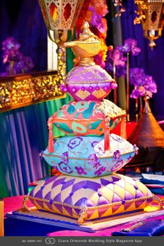 Cake fashioned to look like pillows topped with a genie bottle.
