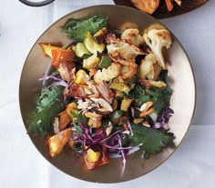 Vegetable Health Bowl: Roasted cauliflower, roasted squash, roasted zucchini, kale, cabbage, almonds, herb ranch dressing