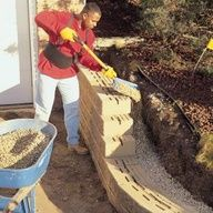 A concrete block retaining wall is the perfect solution to control erosion, to eliminate a hard-to-mow slope, to add a planting bed, or to level an ideal patio area. Concrete Block Retaining Wall, Building A Retaining Wall, Concrete Blocks, Building A Deck, Retaining Wall Construction, Small Retaining Wall, Mix Concrete, Concrete Steps, Concrete Pavers