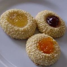 Easy to make sesame seed coated shortbread-type of cookie with jam or preserves in the middle. You choose your favorite fruit. Very tasty.