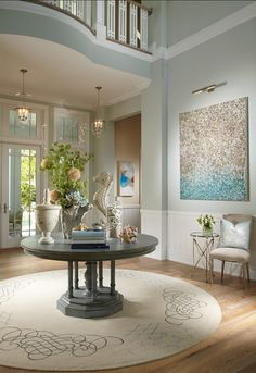 """Paint Color is """"Ocean Air 2123-50 by Benjamin Moore"""". The wainscotting is """"Super White PM-1by Benjamin Moore""""."""