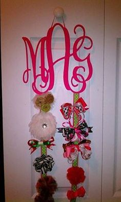 Love this idea - I sell the wooden monograms for $39 - they come unfinished - you finish them anyway you like - then add ribbon and you have an awesome bow holder!  follow me at www.facebook.com/initialoutfitters1