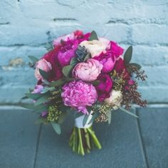 A winter wedding filled with lush, berry colored flowers in Los Angeles, California. Peonies, ranunculus, anemones and more.