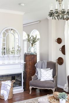 Beautiful mirror above the mantel! Beautiful summer home tour with lots of whites, raw wood tones, and simple summer decorating ideas