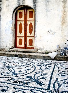 Pebble mosaic floor outside a church on Symi Island, Greece. Image by Katherine Martinelli. www.flickr.com