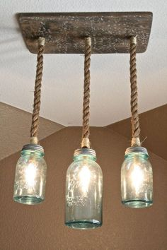 Multiple mason jar DIY lighting ideas, including Mason Jar Triple Pendant Light with Vintage Blue Mason Jars Pot Mason Diy, Diy Mason Jar Lights, Mason Jar Light Fixture, Mason Jar Chandelier, Blue Mason Jars, Mason Jar Lighting, Mason Jar Crafts, Mason Jar Lamp, Mason Jar Pendant Light