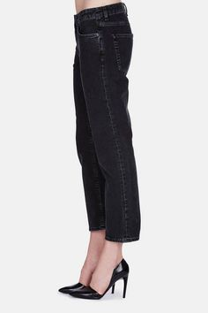 """""""I like a five-pocket, and I'm not too much into fancy stuff,"""" says Acne Studios creative director Jonny Johansson of his denim preferences. """"It has to be very straightforward for both men and women."""" These cropped, zip-fly jeans fulfill all of Johansson's requirements and then some, with a wash that weathers and softens black denim to replicate the patina of years of wear."""