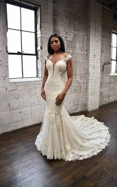 For the glamorous maximalist looking for a show-stopping wedding gown. This fit-and-flare silhouette is anything but simple. A plunging V-neckline and lace-covered off-the-shoulder straps pair with a corset-inspired back for unmatched bodice structure. Cutouts along the side of the waist and in the back are show off the details of the lace pattern. The lace with encrusted beading and stacked layers of floral embellishments. Martina Liana   Style: 1338 Fit And Flare Wedding Dress, Fit N Flare Dress, Bridal Gowns, Wedding Gowns, Backless Wedding, Lace Wedding, Wedding Venues, Dream Wedding, Bella Bridal