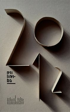 Would make a really effective yearbook cover - 2012// This uses paper/card held up on its side to create the shape of letters. I think this is visually very strong, however simple. It has a simple concept, which makes it stand out. // How else could you use paper to make lettering? Tear it? Print with it? Collage it?//
