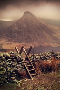 Stile in a stonewall overlooking Tryfan Mountain in Snowdonia, Wales ~ photo Paul Robinson on Flickr
