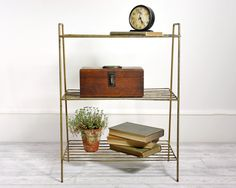 Vintage Mid Century Wire Shelf Table or Plant Stand. $42.00, via Etsy.