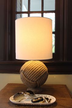 Rope Lamp @Apartment Therapy. I love monkeys fist knots, they are the smallest knot on a fishing boat, but the strongest.