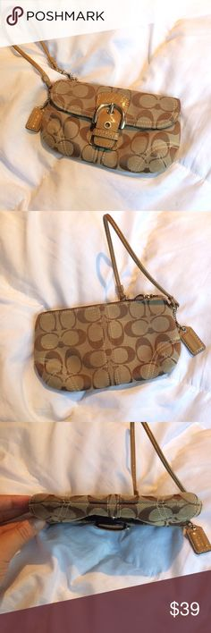 Coach Monogram Wristlet Good used condition coach wristlet. It features the brown signature and a patent leather buckle. This opens up to a front pocket which is an addition to a regular zip wristlet Coach Bags Clutches & Wristlets