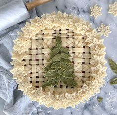 Bicolor green pine tree needles Christmas pie with butter woven strip and braid crust and snowflake trim Christmas Desserts, Christmas Treats, Christmas Pies, Christmas Cross, Christmas Decorations, Holiday Baking, Christmas Baking, Beautiful Pie Crusts, Pie Crust Designs