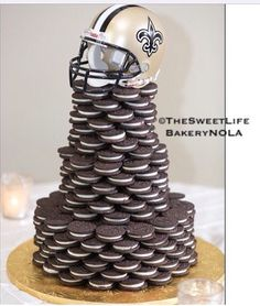 Tiered Oreo saints themed grooms cake by The Sweet Life Bakery New Orleans www.nolasweetlife.com email info@nolasweetlife.com (504)371-5153 #nolasweetlife @nolasweetlife #70124
