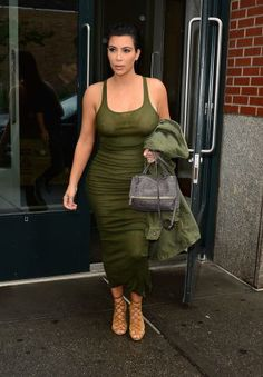 Green dress. Kim Kardashian Style - Kim Kardashian Fashion Photos