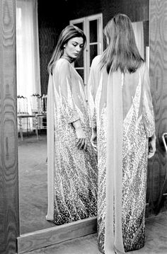Anouk Aimée trying on evening dress at Pierre Cardin's salon, April 1967.