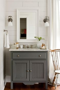 Maintain a plank position.  The new wood walls and ceiling, used in lieu of drywall, give extra character to this bath.     Cover up.  Customize a recessed medicine cabinet by hiding it with a hinged framed mirror.  Choose a freestanding vanity.  A hand-painted, marble-topped sink base feels like antique furniture rather than a standard built-in bath cabinet.