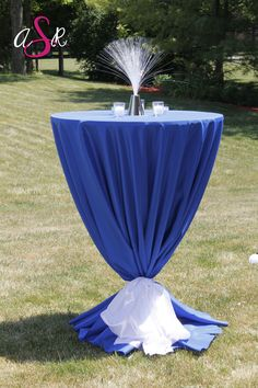 A super fun blue cocktail table! The low tie makes this really unique. #wedding