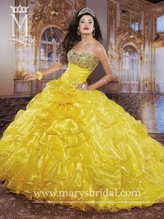 Quinceanera  Princess Strapless, organza ball gown with basque waist, pleated bodice, beads, sequins, and bustled and ruffle skirt, with lace-up back and bolero canary/multi