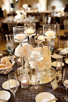 Are you getting married during one of the winter months? If so, you may be searching for inspiration for your wedding to ensure that it turns out as perfect as possible. There are some great winter wedding reception ideas to consider. These ideas could. Winter Wedding Centerpieces, Wedding Table, Our Wedding, Dream Wedding, Wedding Decorations, Table Decorations, Centerpiece Ideas, Wedding Reception, Graduation Centerpiece