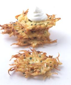 Potato-Parsnip Latkes. Despite a dubious beginning (I was furious with my mother, apparently, who told me parsnips were white carrots. Those were pretty funny-tasting carrots...) I have grown to love parsnips. Nice twist on potato pancakes. Source: Recipe by Gourmet via Epicurious; Image by Romulo Yanes (http://romuloyanes.com)