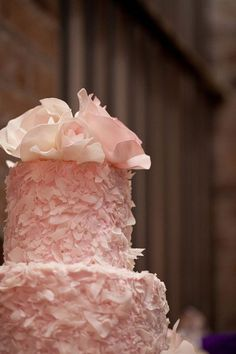 Pink shavings multi tiered cake with roses