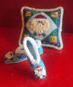 Dollhouse Miniatures Christmas pillow and slippers in 1/12th scale. I accept commissions.