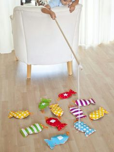 Diy fishing activity for toddlers and kids i plan to put numbers and colors on the fish and have them put tbem in corresponding buckets