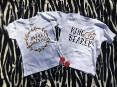 Flower girl and ring bearer shirts. The perfect gift for the little ones in your bridal party. How adorable would these be for them to wear at the rehearsal?! Part of our flower girl and ring bearer gift boxes. www.openuphappiness.com
