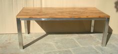 Sleeper wood table with stainless steel legs. 82W x 38D x 31H