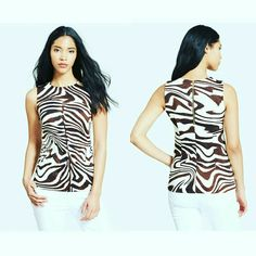 29 (SALE) HP NWT Michael Kors Zebra Top ✨NEW WITH TAGS✨  Never been used before  - Very pretty, perfect for the holiday party - Throw some blazer or jacket around, and you're ready to rock the party - Black and White Zebra Patern - Sleeveless, beautiful pattern, very flowy and light-weight - Exposed back-zip closure - Uneven hem, short in the front, long in the back - Fits XS, S Michael Kors Tops Blouses