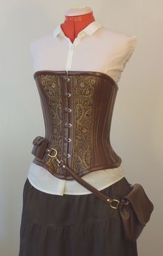Possibly something like this corset/bag combo for Z instead of a breastplate.  Breastplate with a bag?