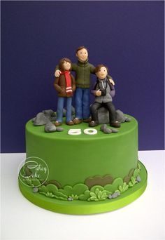 A Birthday cake for a man who enjoys family walks in the countryside with his wife (a keen photographer) and daughter (an Arsenal fan). I really enjoyed making this one – it's been a while since I allowed myself enough time to get completely. Dad Cake, 50th Cake, Fondant Cakes, Cupcake Cakes, Rock Climbing Cake, Biscuit, Guitar Cake, Family Cake, Retirement Cakes