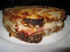 Croque Monsieur by Ina Garten.  Terrific for a Soup and Salad Party when it's cold outside.  I make them assembly line-style on half sheet pans in advance and store the pans in the refrigerator until just before the party. Three great soups and the best ham and cheese sandwich in the world?  Yumm!