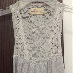 Hollister Lace Top worn twice. some pilling along the hem of the lace, but lace itself is in great condition. it's slightly cropped but not very Hollister Tops