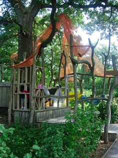 salvaged & found lumber makes a fine play area suitable for all ages. make it extra sturdy if the kids will be climbing on it.