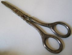 "Antique German 800 Silver Grape Scissors Shears Acier C 1900 ; Beautiful grape scissors made of steel with silver handles. Marked with ""Acier"" manufacturer's mark on the blades and ""800"" German silver standard mark on the handles- 6.5"" long"