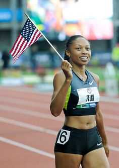 Allyson Felix finishes her victory lap after placing first in the finals of the women's 200-meter dash at the U.S. Olympic Trials.