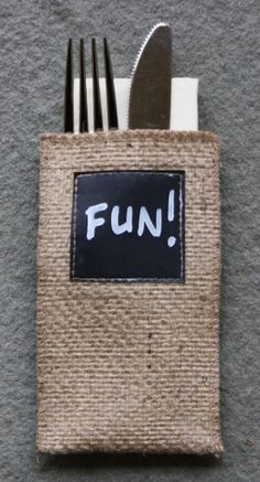 Chalkboard Burlap silverware pouch.  The possibilities are endless when you use a chalk pen....easily wipes clean for a never ending clean slate.