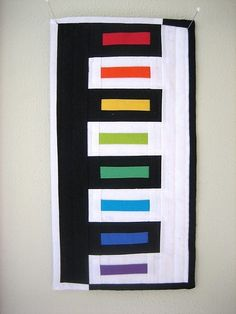 Rainbow bars in negative space. Modern quilt by jodi