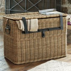 "Ballard Traveler's Wicker Chest. $299. 24""H x 32""W x 18""D. Black metal latches and buckled saddle leather strap. For storing snuggle blankets next to the couch."
