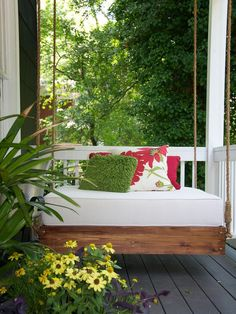 Shabby Chic Decorating Ideas for Porches and Gardens: This hanging daybed is a contemporary take on shabby chic. Bolder colors and bigger prints are seen in the pillows, but the use of a functional bed on a porch is a reminder of shabby chic's comfortable and relaxed sensibilities. From DIYnetwork.com